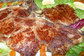 Prelibata carne cotta su pietra lavica alla Trattoria L'Arcangelo di Brescia